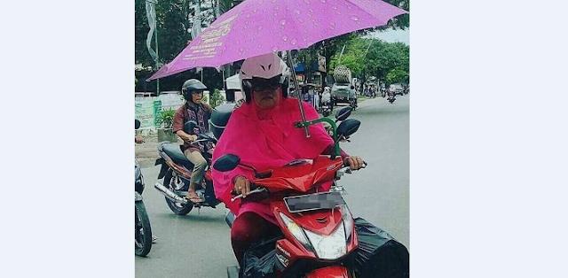 Demi Hindari Panas Matahari, Lihat Cara Unik yang Dilakukan Emak Satu Ini