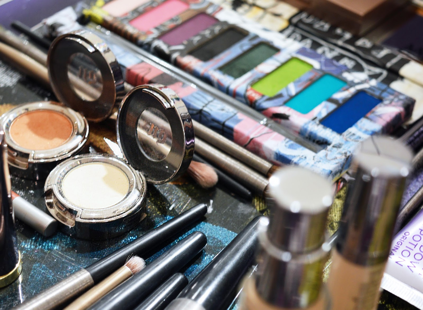 A messy make-up counter, eyeshadows open