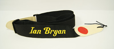 Black guitar Strap with yellow name embroidery