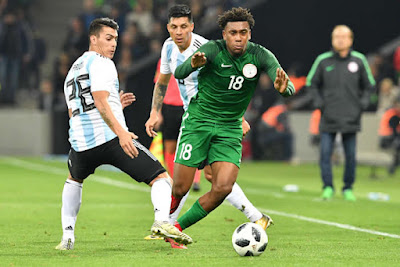 Alex Iwobi dribbles past Argentina players in a friendly match. Nigeria won 4-2.