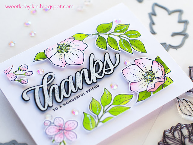 Embellish the card with iridescent jewels to match the soft colour palette