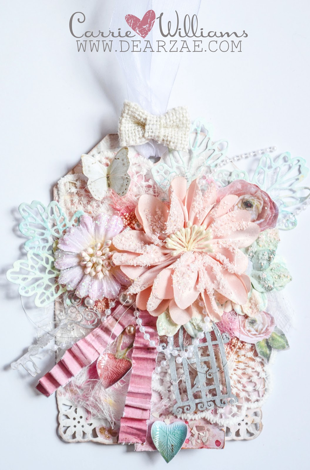 Shabby chic vintage mixed media tag with die cuts and Prima flowers and lace