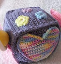 http://www.ravelry.com/patterns/library/baby-play-block