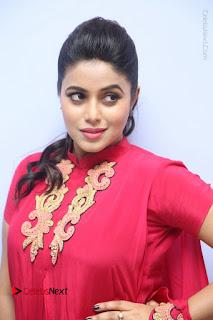 Actress Poorna Latest Stills in Red Dress at Rakshasi First Look Launch  0018.JPG