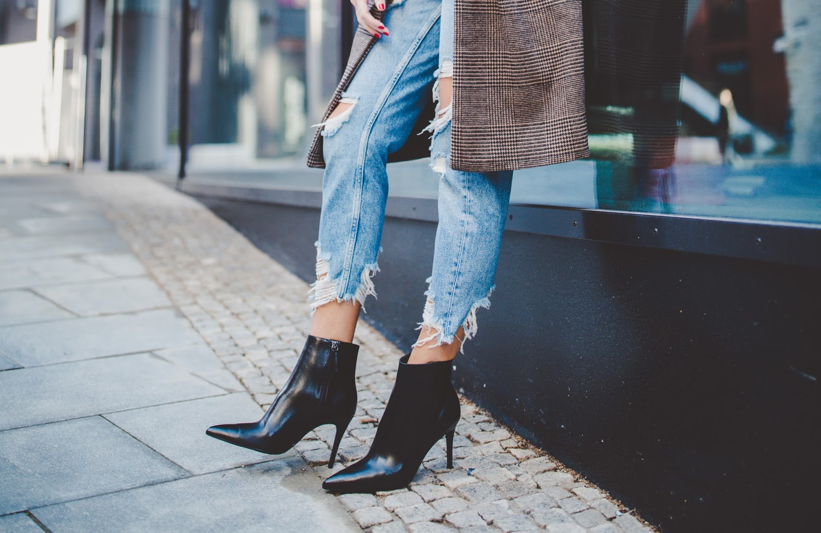 black ankle boots ripped jeans
