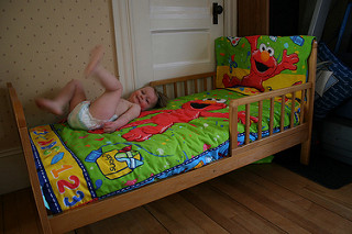 Image: Sam's big girl bed at my mom's house has Elmo bedding!, by Abigail Batchelder (abbybatchelde) on Flickr