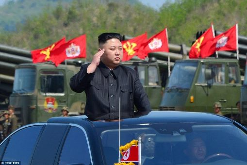 Kim Jong-Un salutes as the North Korean army fires rockets & torpedoes at mock enemy warships (photos)