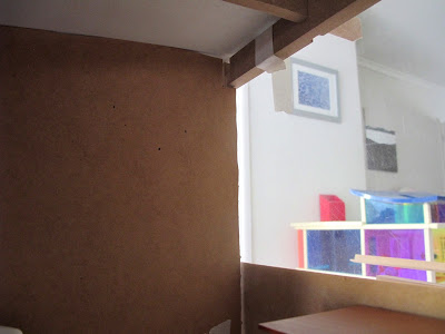 Inside front view of a dry fit of a dolls' house shed kit, with a central wall installed.
