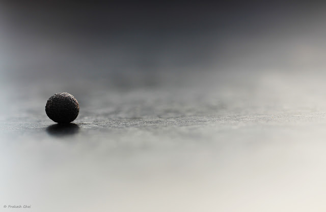 Photo of a Black Ball and its Reflection on a Table