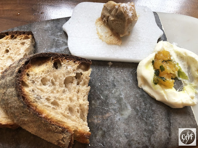 Homemade whole wheat sourdough bread and housemade date butter at Oak and Rowan restaurant, Fort Point, Boston, MA