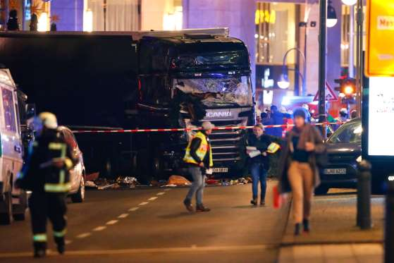 Truck plows into crowd at Berlin Christmas market, nine dead