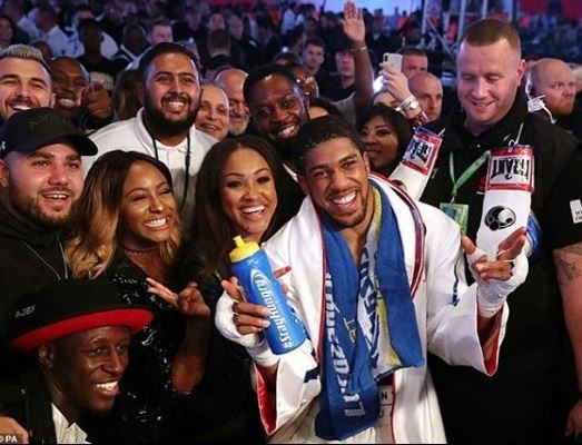 DJ Cuppy poses with Anthony Joshua after his victory against Povetkin in London