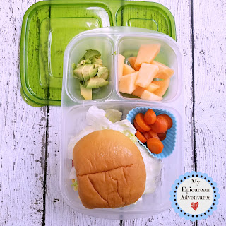 Lunch box fun with a ham and cheese sandwich on a deliciously soft potato roll. In our @easylunchboxes #lunchboxideas