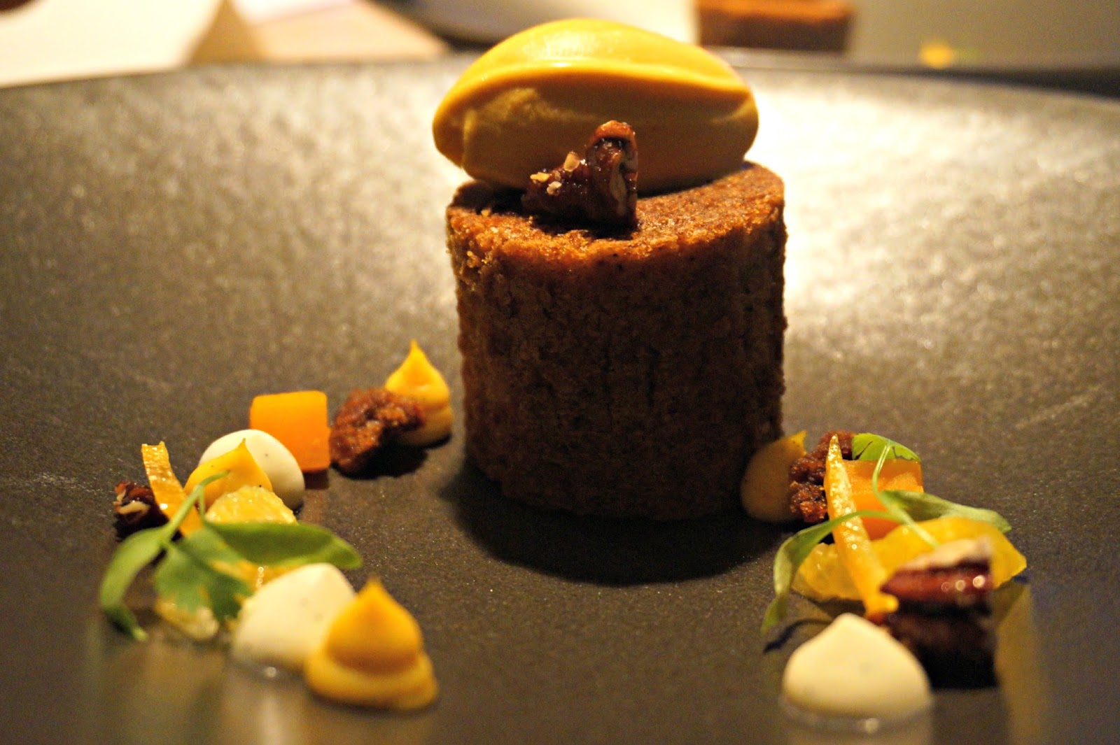 A pumpkin and orange sponge cake topped with caramalised pecans, carrot ice cream and a pumpkin and orange sauce