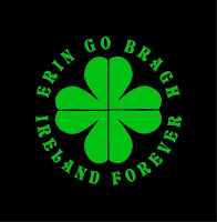 "A green sharmrock on a black background with the words, ""Erin Go Bragh Ireland Forever"" in green surrounding the shamrock."