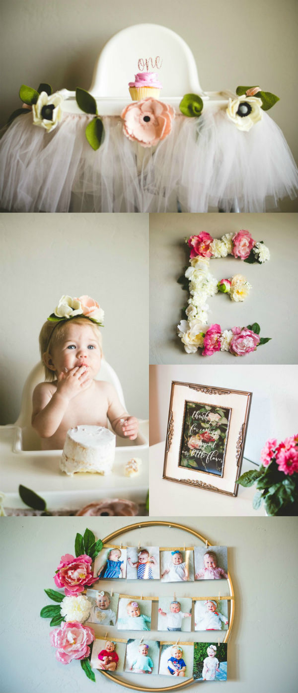 One year old girl with her floral first birthday party decorations.