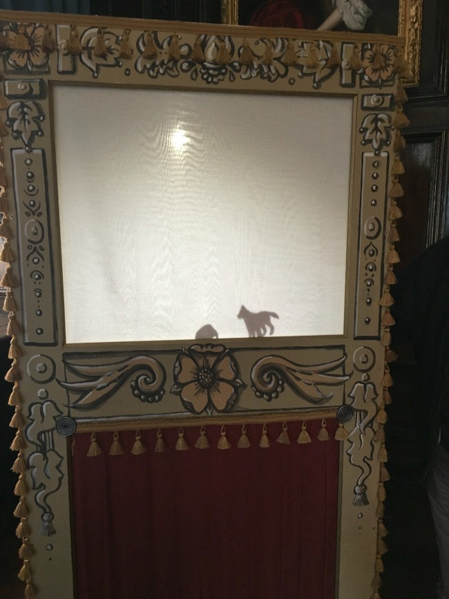 shadow-of-a-dog-in-a-shadow-puppet-theatre