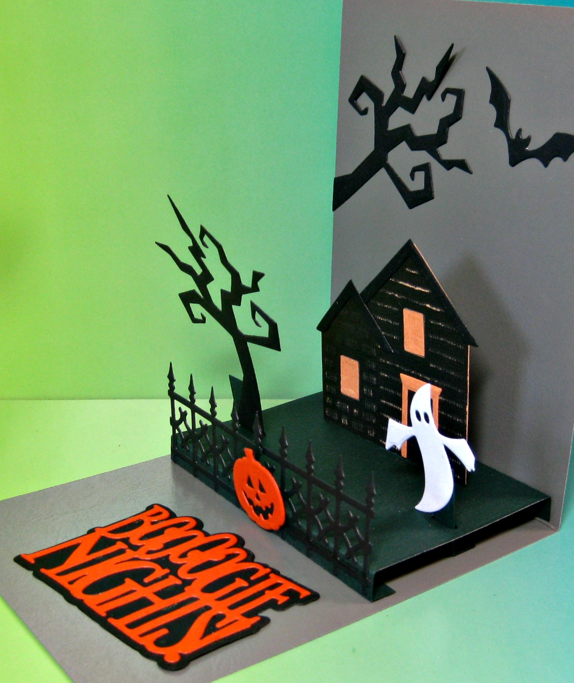 even if you have no use for halloween cards and dont own a million dies like me i am an addict and i admit it this house and fence pop up die
