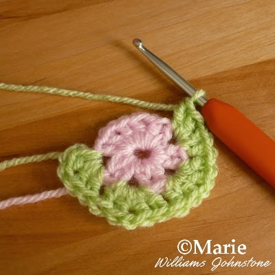 Pink and green circular motif of crocheting