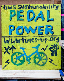 a sign about bicycle power generation at the occupy wall street camp at zuccatti park