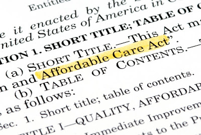 A close-up photo of the Affordable Care Act document.