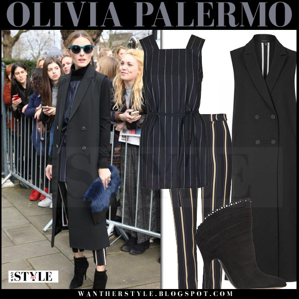 Olivia Palermo in black sleeveless topshop coat, navy striped topshop tunic and striped pants front row what she wore lfw