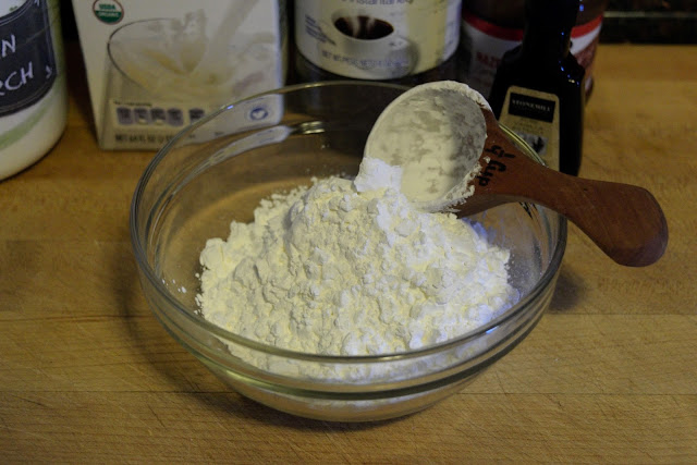 A mixing bowl on the counter with confectioners sugar in it.  we are beginning the glaze.