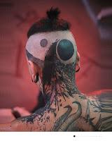 tatouage crane lune noire olivier poinsignon
