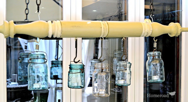 large green turned post with hanging mason jars