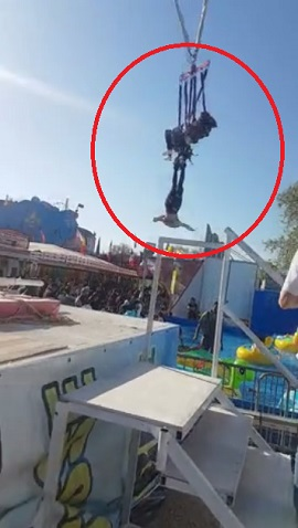 woman, fall, fell, feet, foot, ride, dangles, swing, rope, woman falls from ride, france, paris, foire du trone porte doree, full video, complete video,