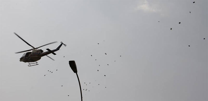 Yay or Nah? Police sensitize Abuja residents by throwing fliers from helicopter