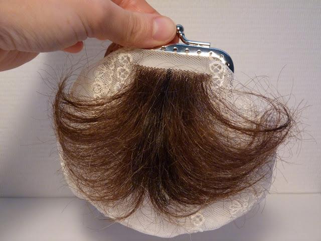 art textile contemporain, installations cheveux, volumes brodés au cheveu