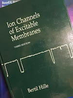 Ion Channels of Excitable Membranes, by Bertil Hille, superimposed on Intermediate Physics for Medicine and Biology.