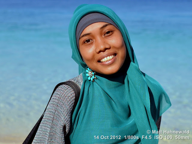street portrait, Indonesia, Central Sulawesi, young Indonesian Muslim lady, blue hijab, beach, beauty, charming, outgoing, smiling, posing