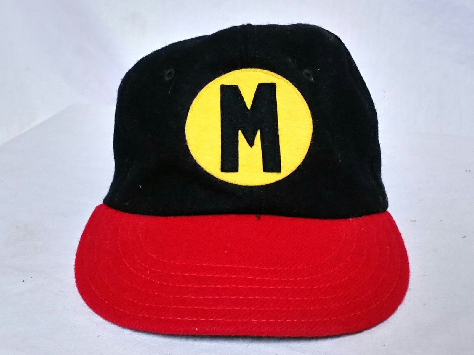 34183a6f3 The cap they offered for Milwaukee was black with a red bill and squatchee