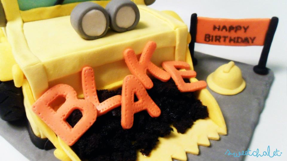 Dotted border around fondant letters to resemble metal work