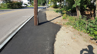 nice work expanding the sidewalk to provide room around the utility pole