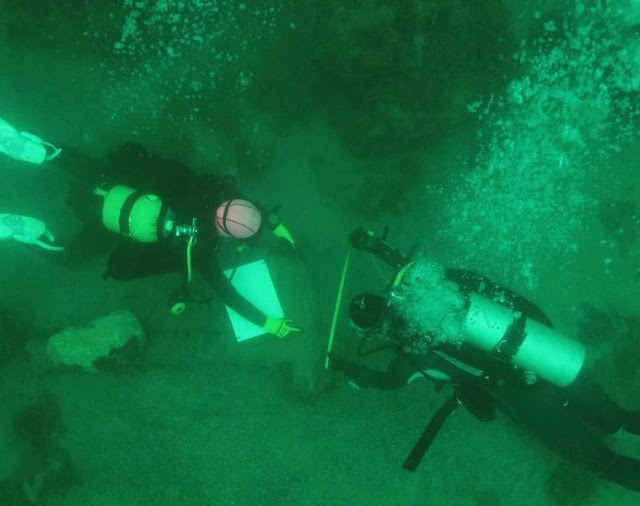 Divers recover several hundred artefacts from sacred Mayan lake in Guatemala
