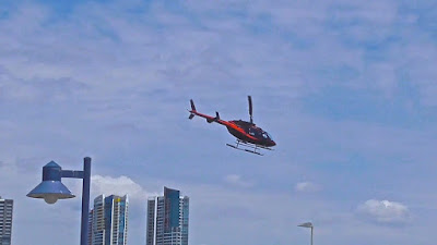Helicopter near High Rise apartments