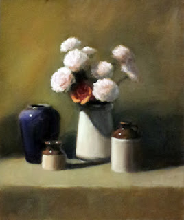 Oil painting a cream-coloured porcelain jug containing light pink plastic carnations and an orange rose, with two earthenware jars and a blue vase beside.