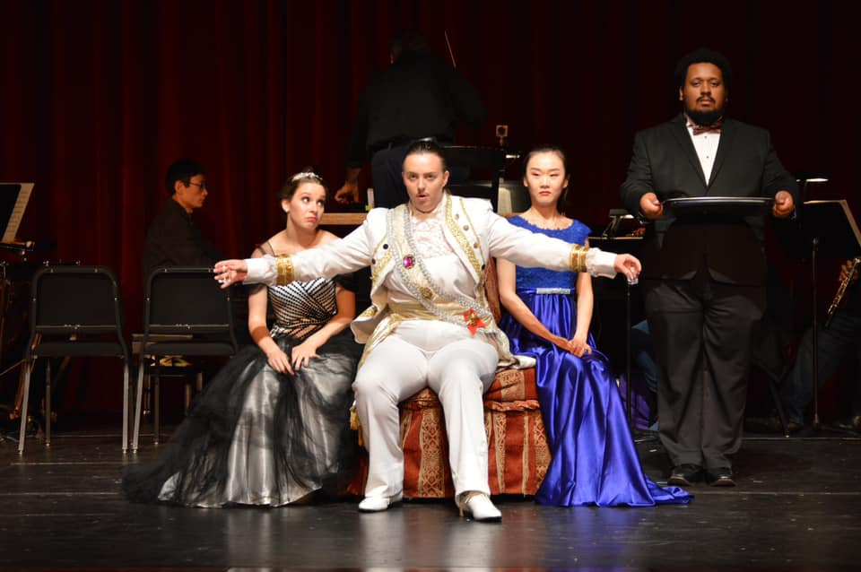 IN REVIEW: (from left to right) soprano CLAIRE GRIFFIN as Adele, mezzo-soprano BAILEY LAIL as Prinz Orlovsky, soprano MUJUN XIE as Ida, and bass RAFAEL ALEJANDRO GARCIA as Ivan in UNCG Opera Theatre's production of Johann Strauss II's DIE FLEDERMAUS [Photograph © by Amber-Rose Romero, Tamary Beliy, & UNCG Opera Theatre]