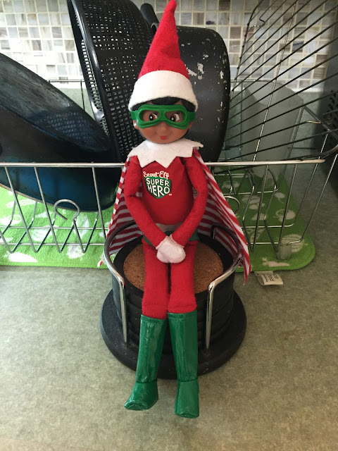An elf doll dressed as a super hero