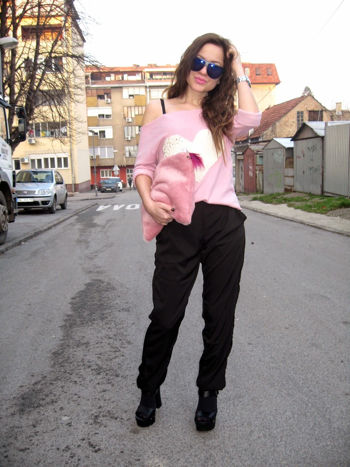 outfit, valentines day, valentines outfit, pink faux fur bag clutch, pink sweater with heart, black chunky shoes heels, black pants, lindex sunglasses