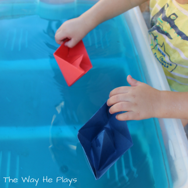 Coloured paper boats and coloured water
