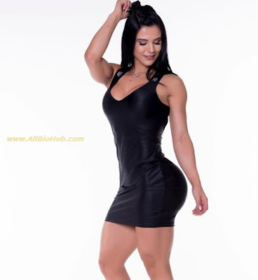 Eva Andressa in black short dress