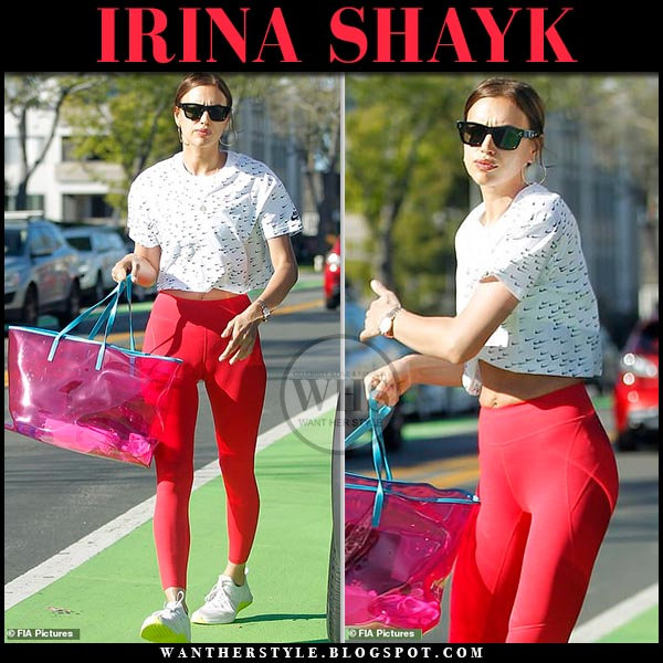 089e8d4e02 Irina Shayk in white Nike logo crop top, red leggings and pink transparent  Versace 90s