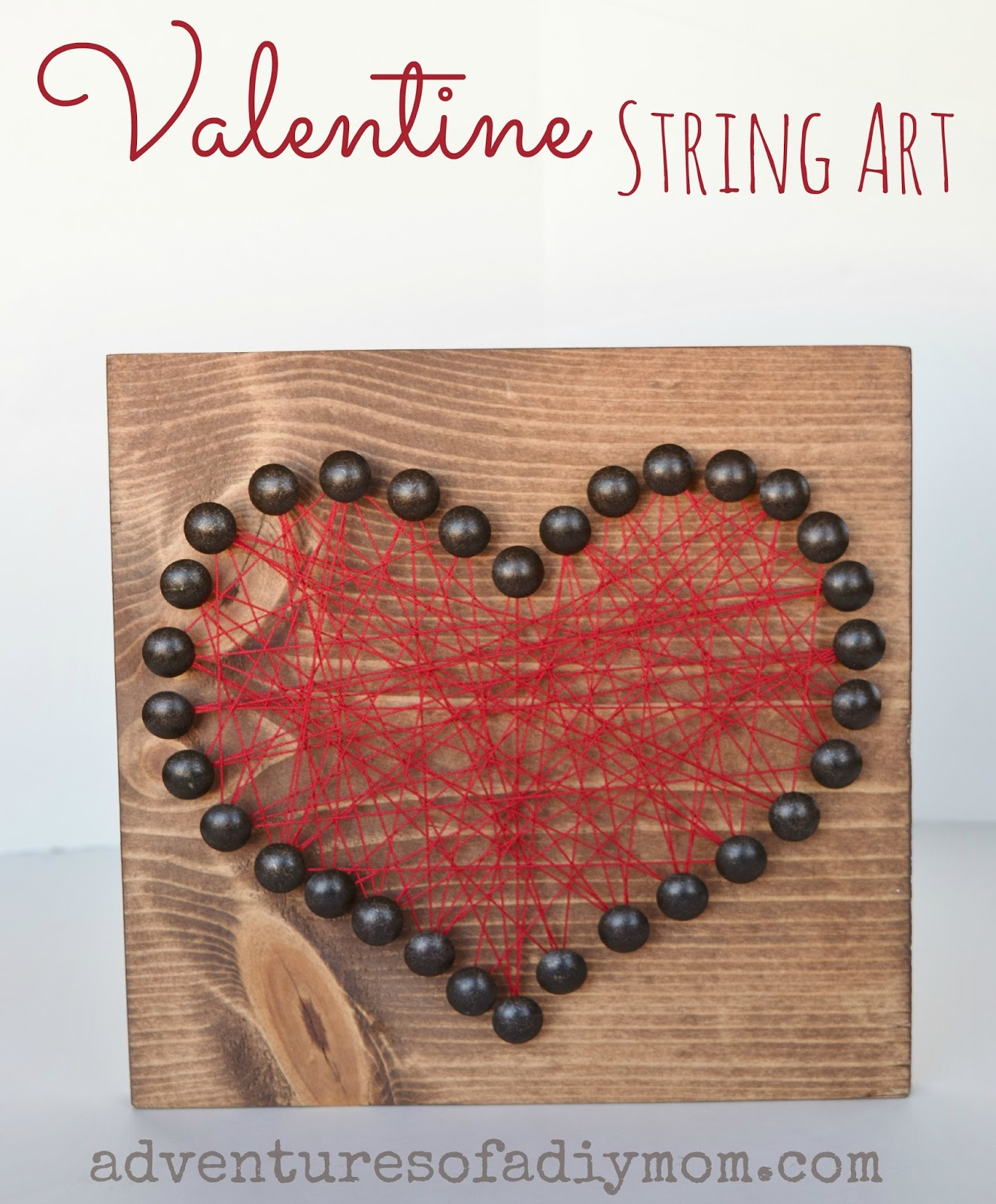 Learn to make a fun string art heart using upholstery nails for a unique look