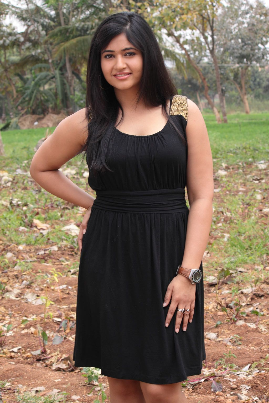 Poonam Bajwa Thighs Show Stills In Mini Black Dress