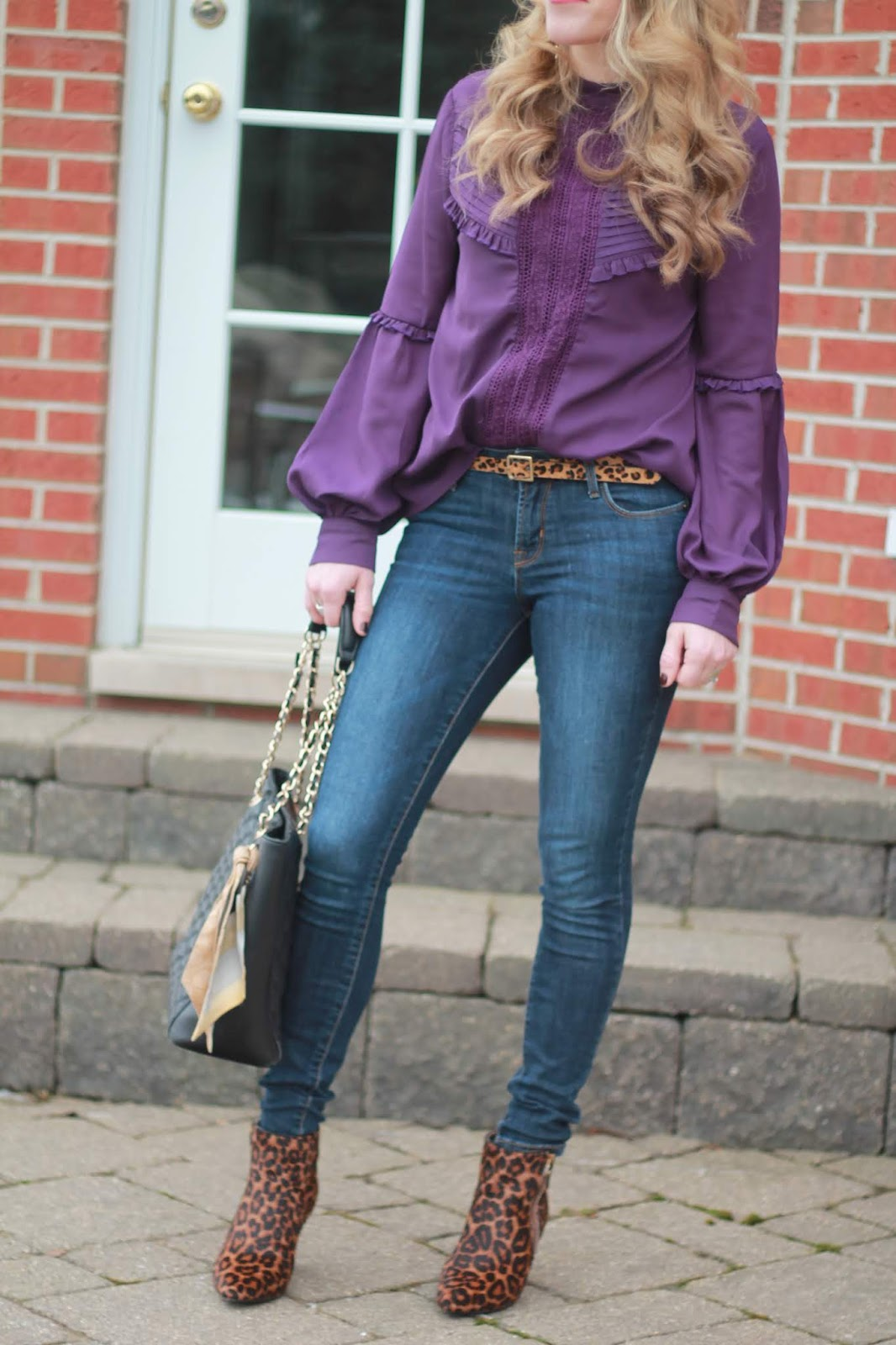 purple ruffle blouse, Rockstar jeans, leopard booties, leopard belt, black quilted leather tote