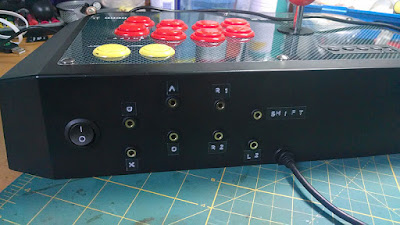 HORI Real Arcade Pro fitted with switch sockets and surface buttons on/off switch. Rear view.